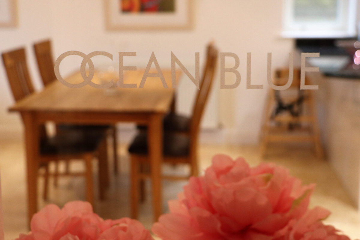 Trebetherick Ocean Blue Holiday apartment Cornwall through the glass
