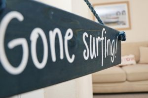 Sandpiper holiday home surfing sign